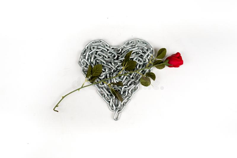 The thick metal chain folded by heart on white background isolated stock photos