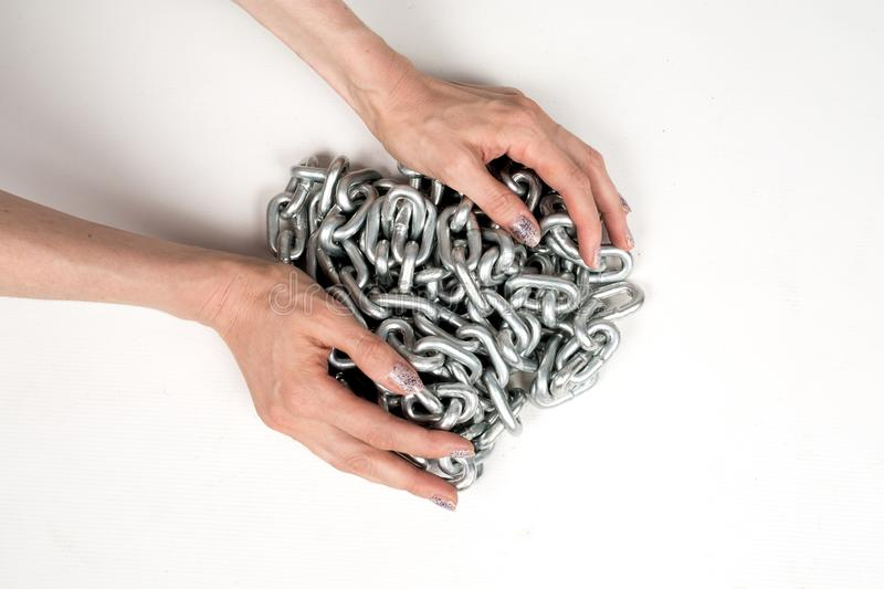 Thick metal chain in women`s hands on white background isolated royalty free stock photo
