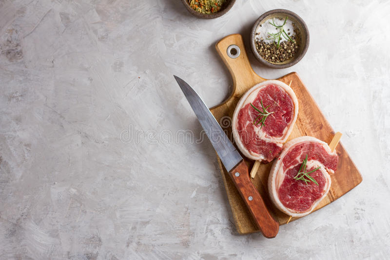 Thick raw beef roll with seasoning stock image