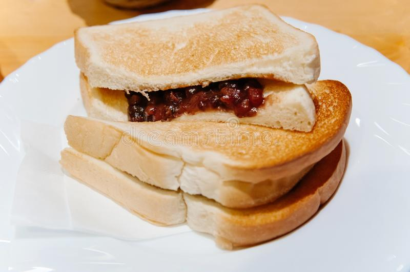 Thick slices of Ogura toast local breakfast of Nagoya - Japan. Thick slices of Ogura toast - red bean paste toast with butter, local breakfast of Nagoya - Japan stock photo