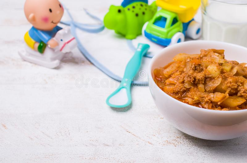 Thick soup for baby food. With vegetables and meat in a bowl on wooden background. Selective focus royalty free stock photos