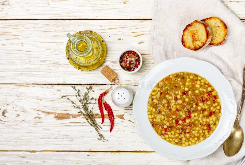 Thick soup with vegetables carrots, onions, tomatoes, pasta, lentils and spices. Minestrone stock image