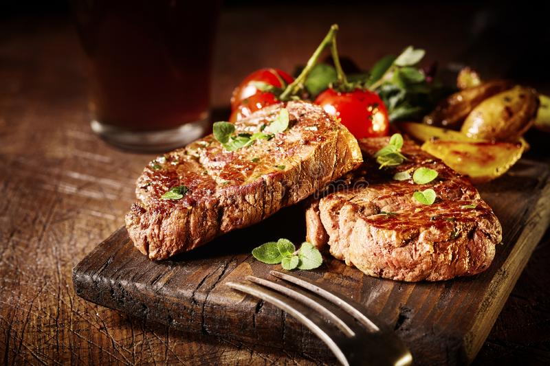 Thick tender roasted or grilled fillet medallions royalty free stock images