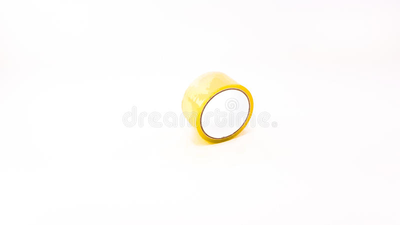 Thick transparent plastic tape with white big core. Isolated royalty free stock photography