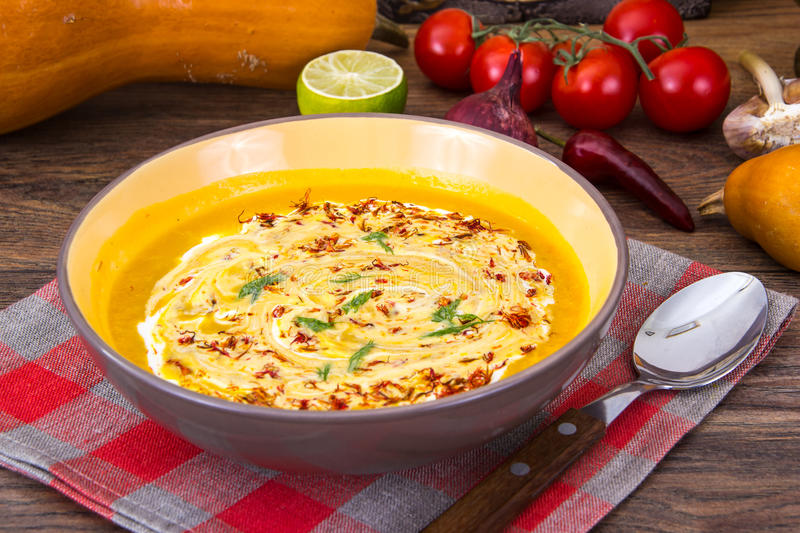 Thick vegetable soup with yoghurt and saffron stock images