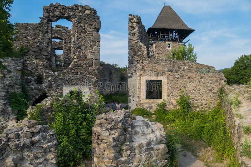 The thick walls of the mighty defensive fortress of the Nevytsky castle were destroyed by Uzhgorod. Ukraine. For your design stock photography