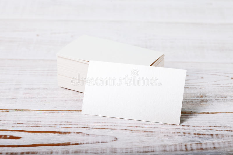Thick white cotton paper business card mock up on vintage wooden deck stock photo