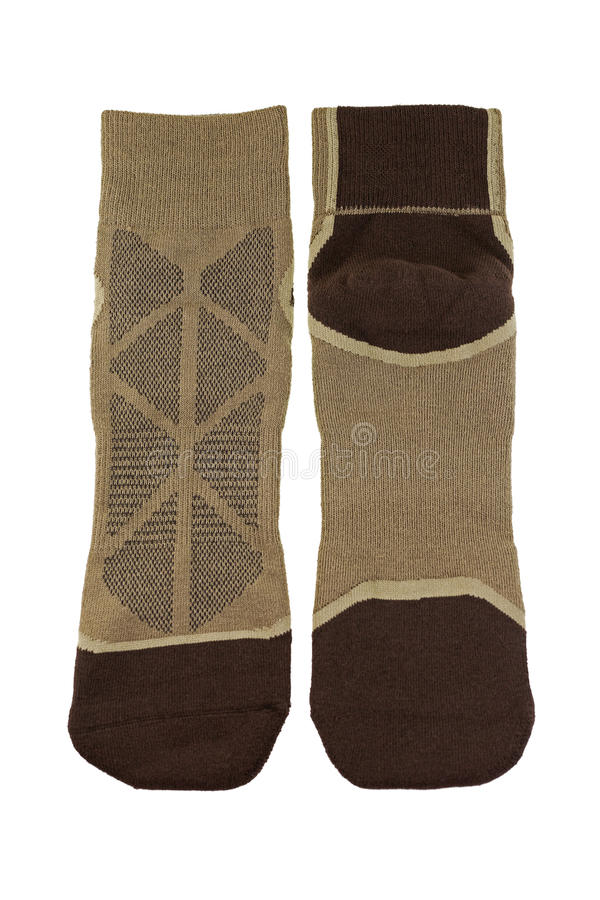Thick wicking socks in brown color. Comfortable hiking soft sock. S isolated on white background royalty free stock photography