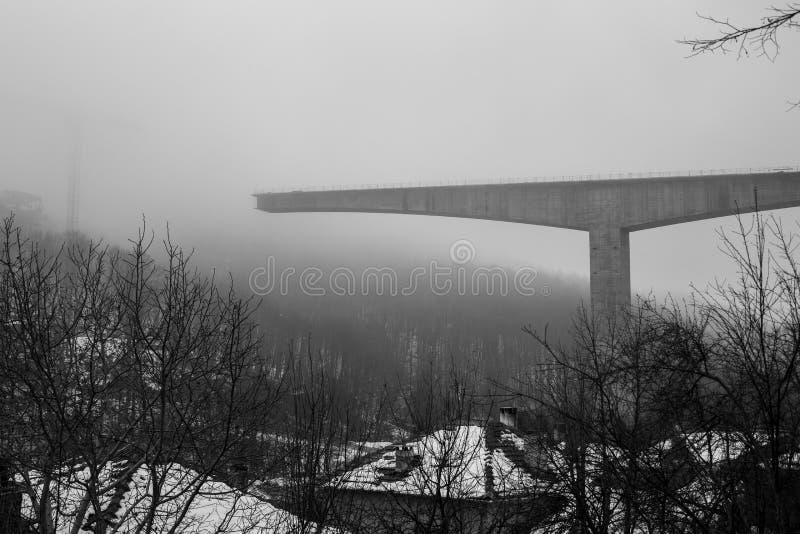 Thick winter fog and bridge construction stock photo