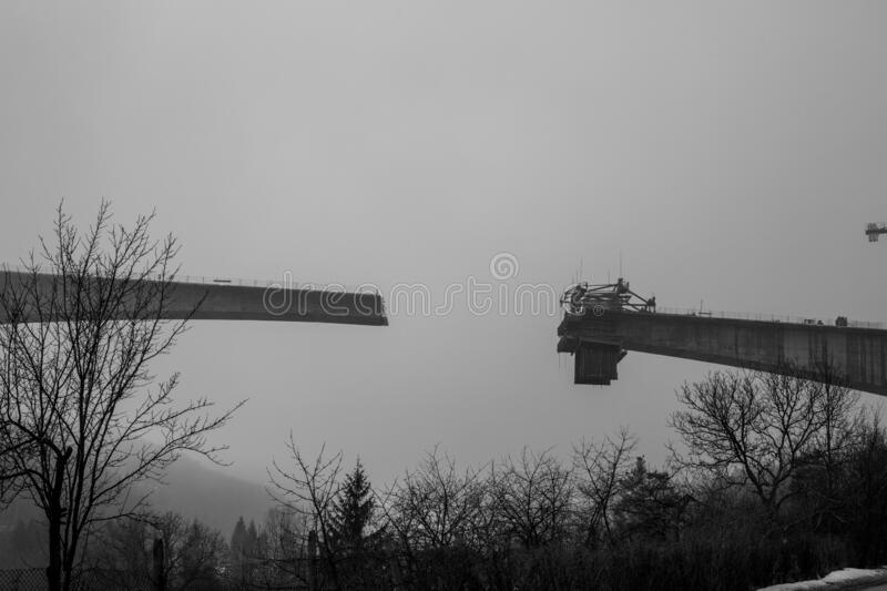 Thick winter fog and bridge construction royalty free stock photo