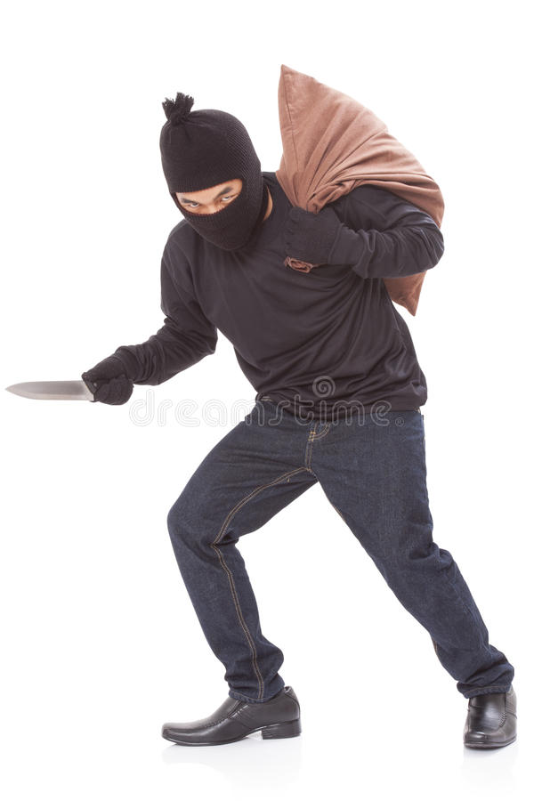 Thief with bag and holding knife stock photo