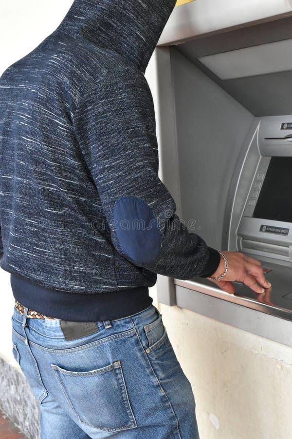 Thief at bankomat stock photos