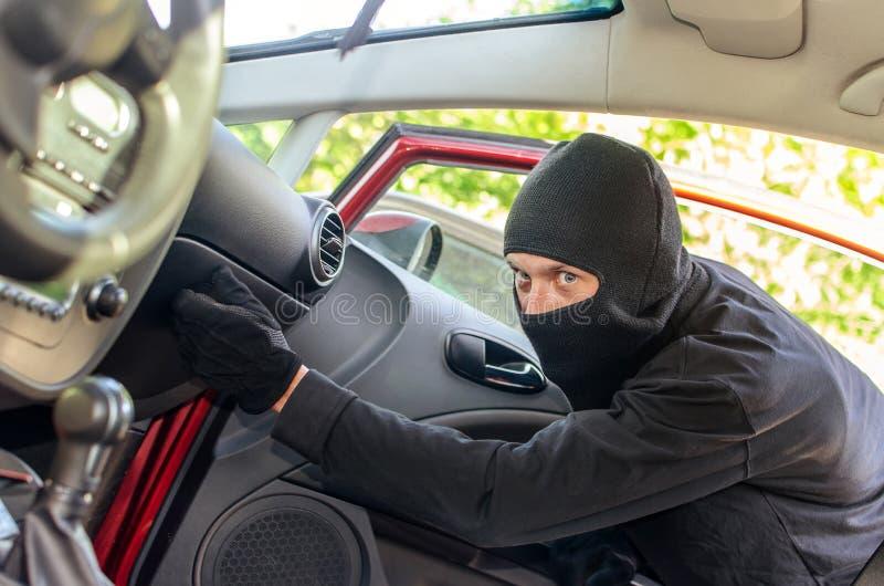 Thief breaks the door in the car stock photography