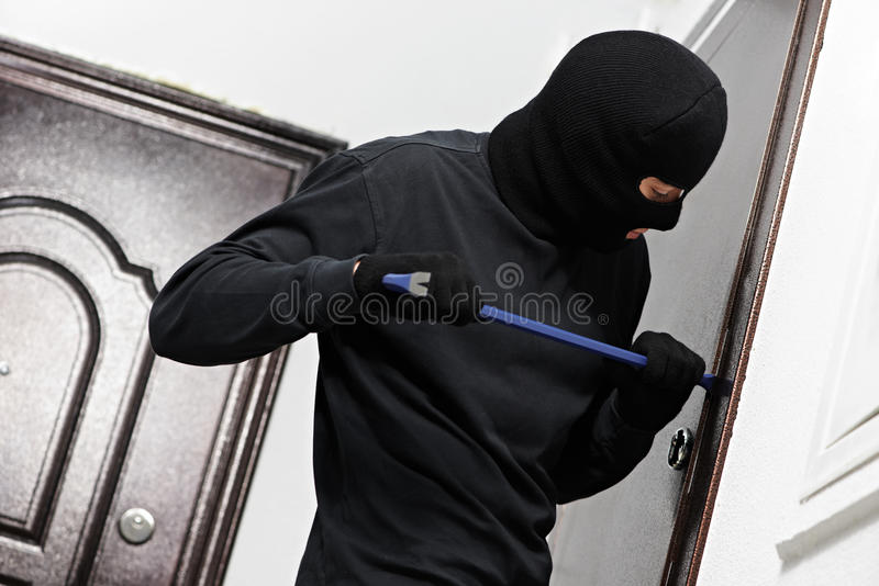 Thief burglar at house breaking royalty free stock photos