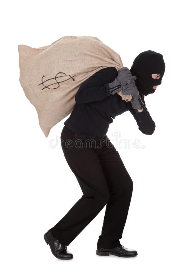 Free Thief Carrying A Large Bag Of Money Stock Photo - 28845660