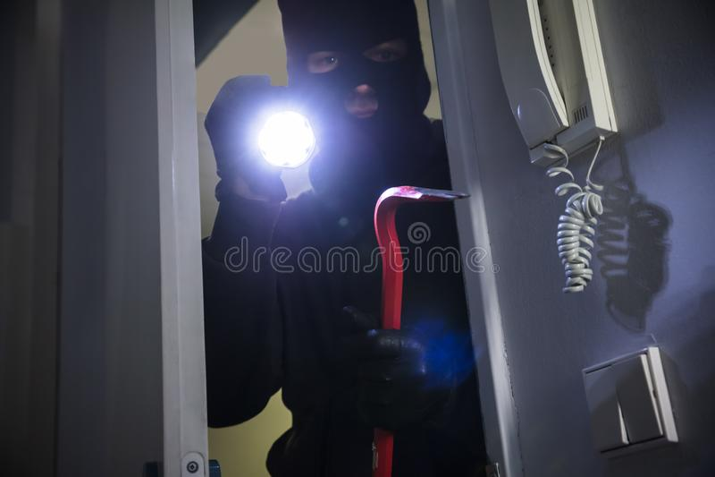 Thief Entering Into House stock photo