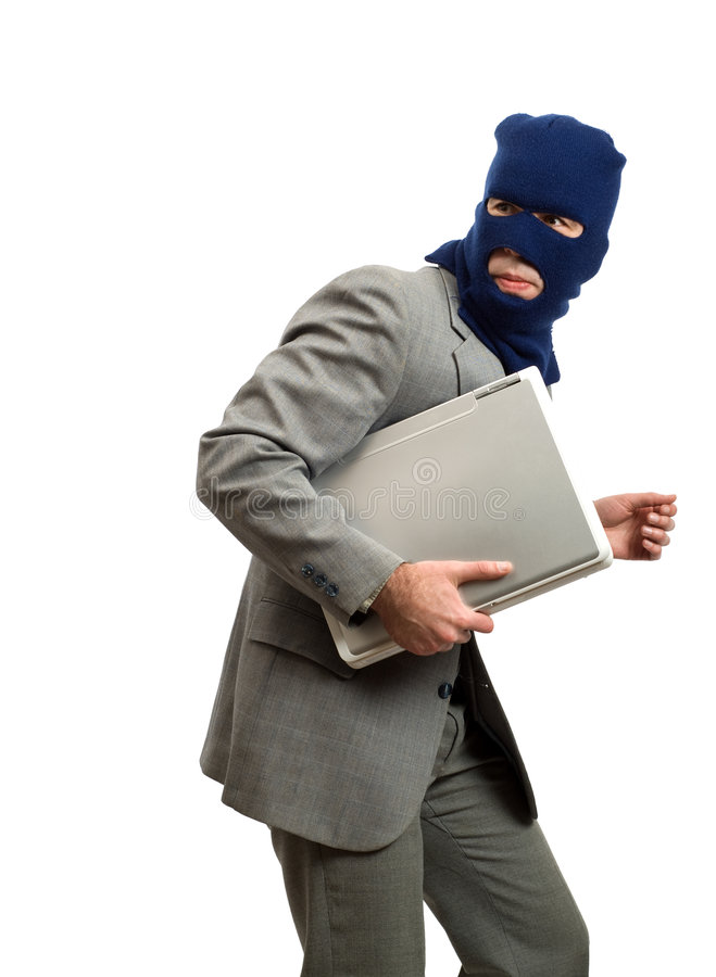 Thief Getting Away. A computer thief is getting away with a laptop royalty free stock image