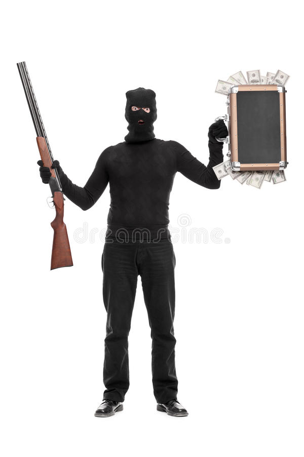 Download Thief Holding Bag With Money And A Shotgun Stock Photo