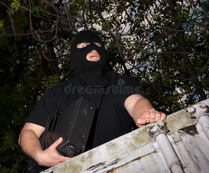 Download Thief in a mask stock image. Image of background, device - 9495067