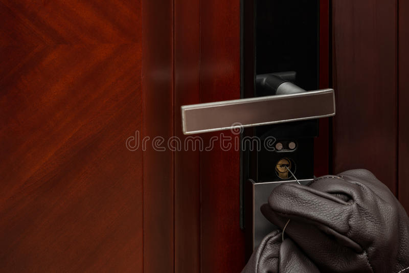 Thief opening a door lock royalty free stock image