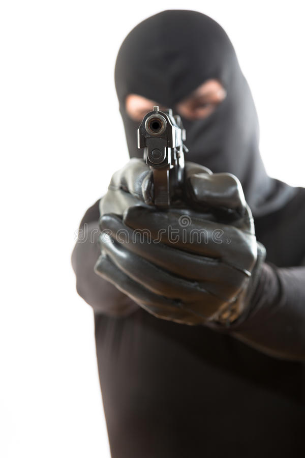 Thief pointing a gun royalty free stock photography