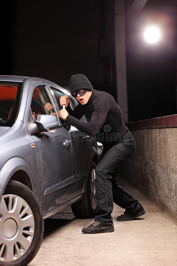 Download Thief With Robbery Mask Trying To Steal A Car Stock Photo - Image: 32358788