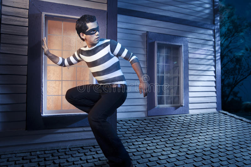 Thief on the roof of a house at night