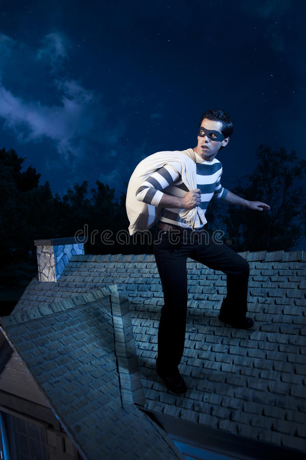 Download Thief On The Roof Of A House At Night Stock Image - Image: 19328801