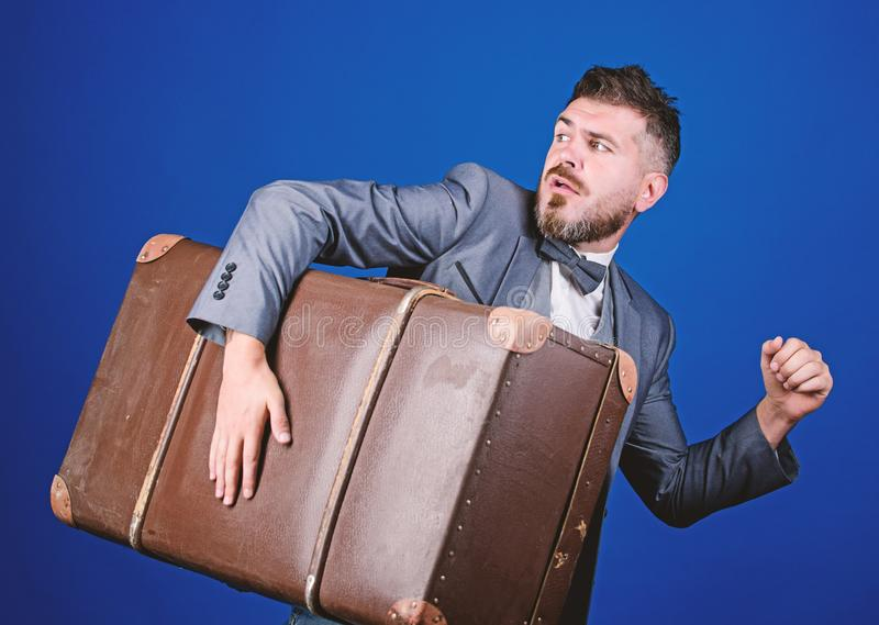 Thief run away with heavy suitcase. Theft of century. Delivery service. Travel and baggage concept. Hipster traveler. With baggage. Baggage insurance. Man well royalty free stock image
