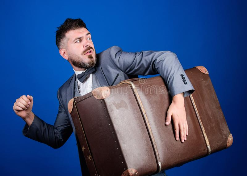 Thief run away with heavy suitcase. Theft of century. Delivery service. Travel and baggage concept. Hipster traveler. With baggage. Baggage insurance. Man well stock photos