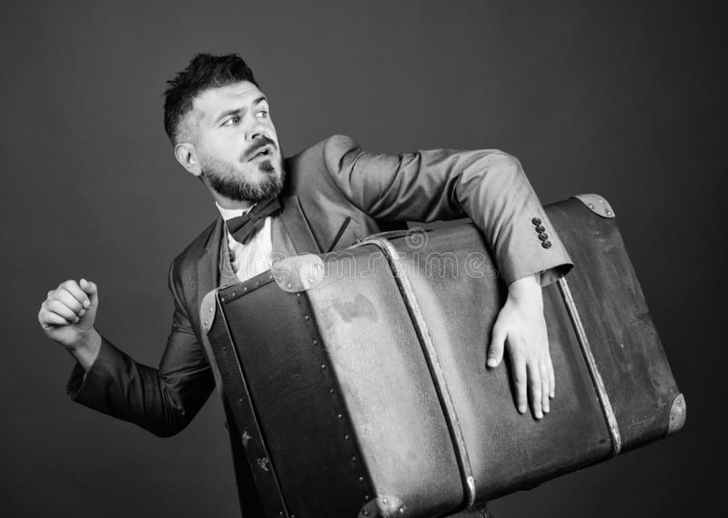 Thief run away with heavy suitcase. Theft of century. Delivery service. Travel and baggage concept. Hipster traveler. With baggage. Baggage insurance. Man well stock photography