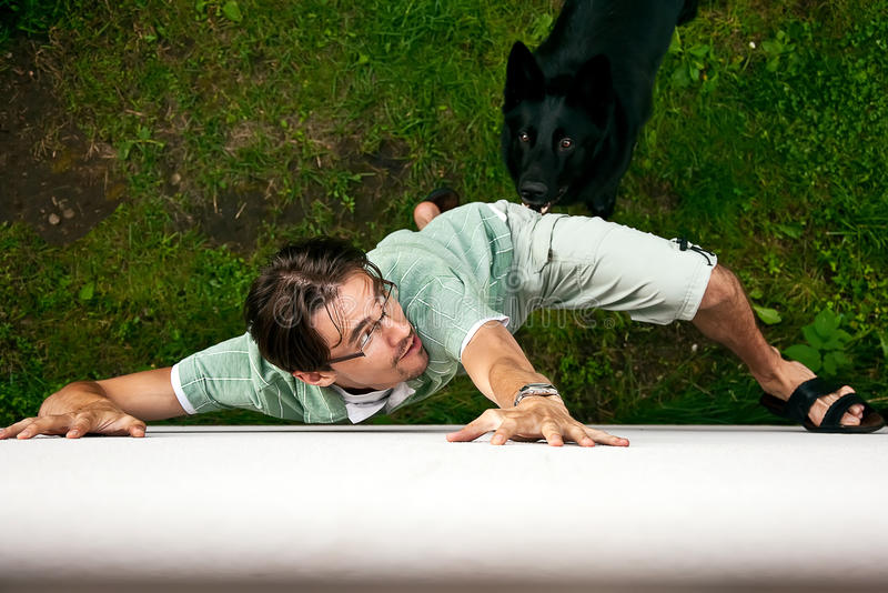 Thief running from dog. stock images