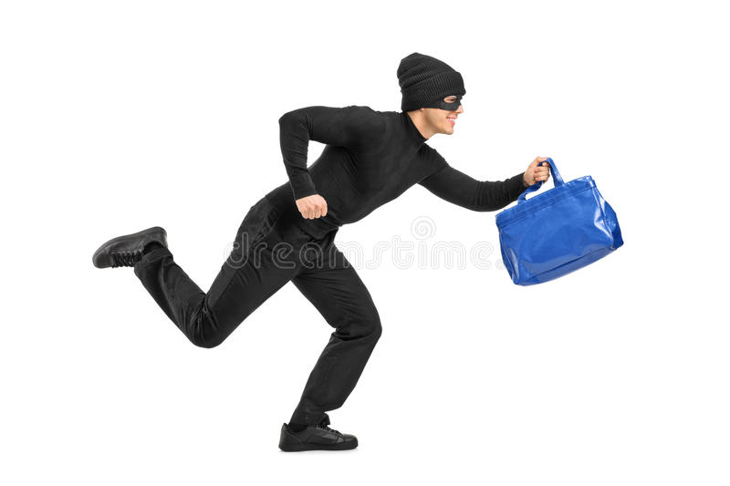 Thief Running With A Stolen Purse Royalty Free Stock Photos