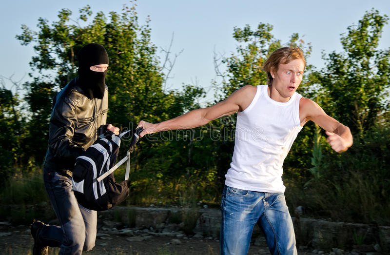 Thief Stealing A Backpack Royalty Free Stock Photo