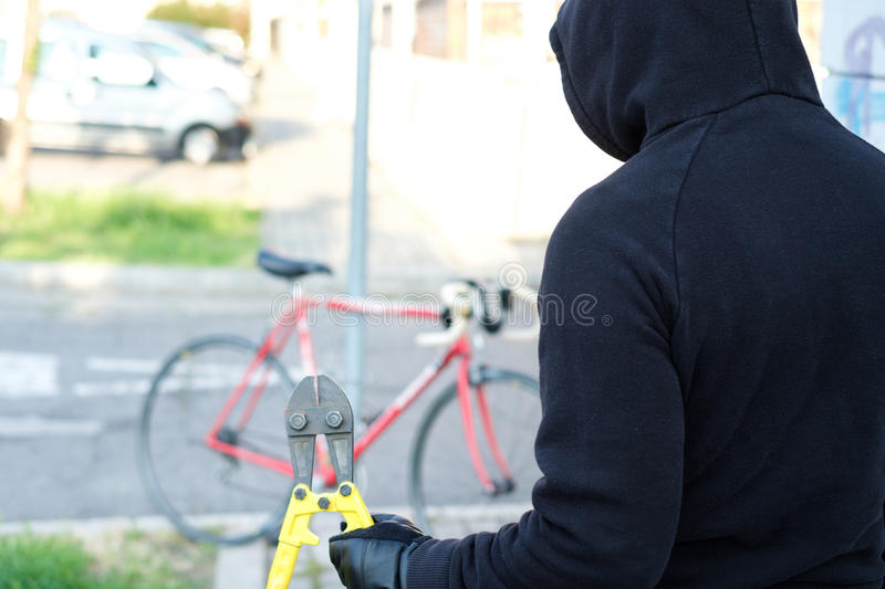 Thief stealing a bike in the city street royalty free stock photos