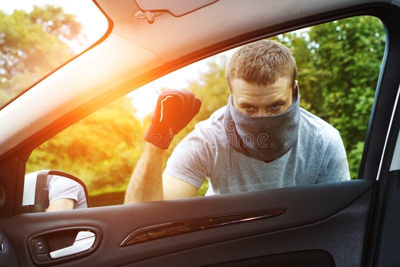 Thief stealing a car royalty free illustration