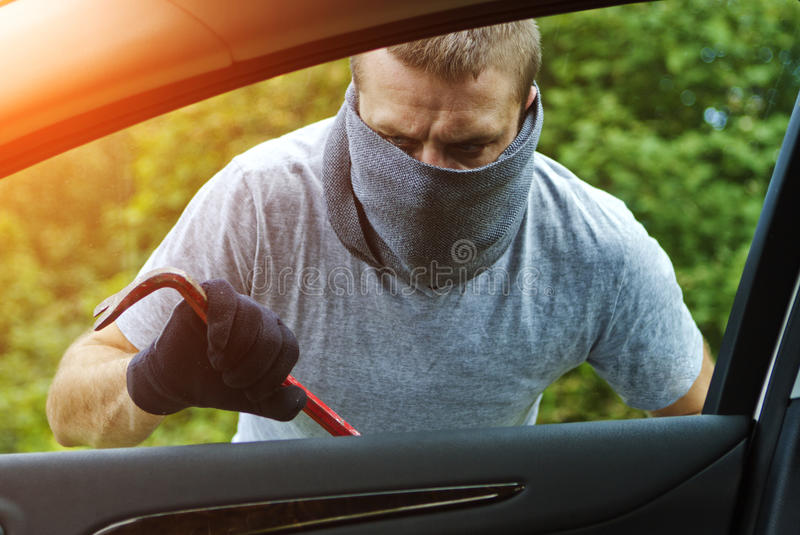 Thief stealing a car stock illustration