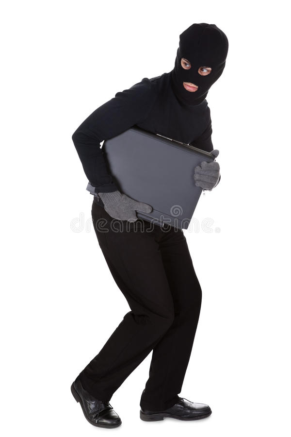 Thief stealing a laptop computer stock photography