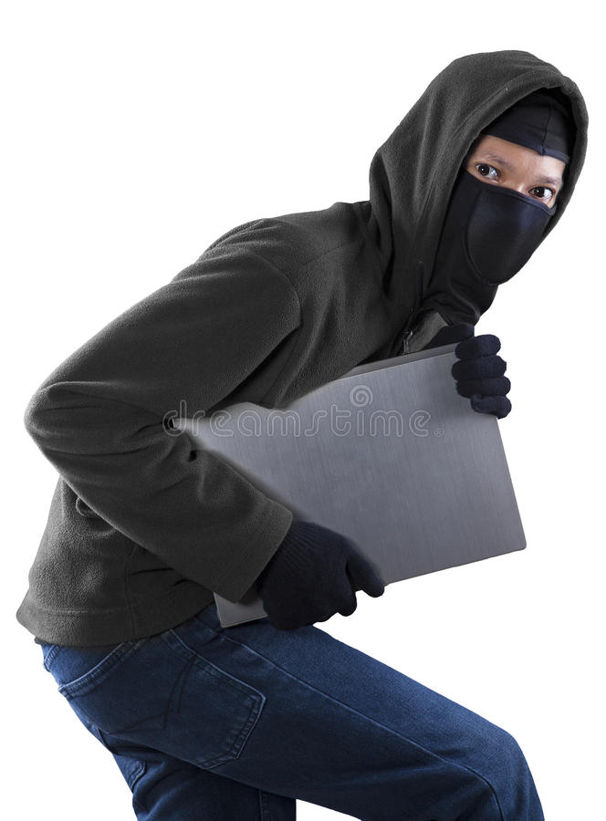 Thief stealing a laptop computer royalty free stock photography