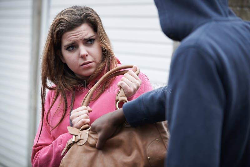 Thief Stealing Teenage Girl's Handbag stock photography