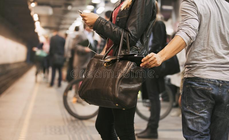 Thief stealing wallet at the subway station stock photos