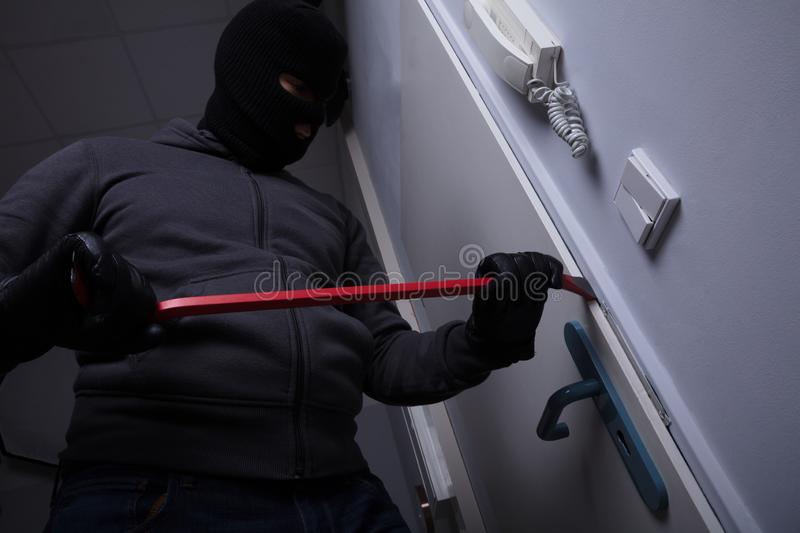 Thief Trying To Break The Door royalty free stock image