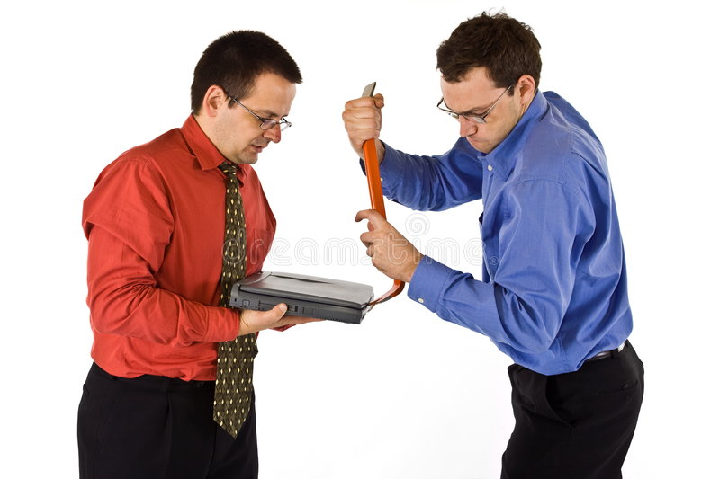 Thieves. Business mans attempting to crack a laptop and steal information stock images