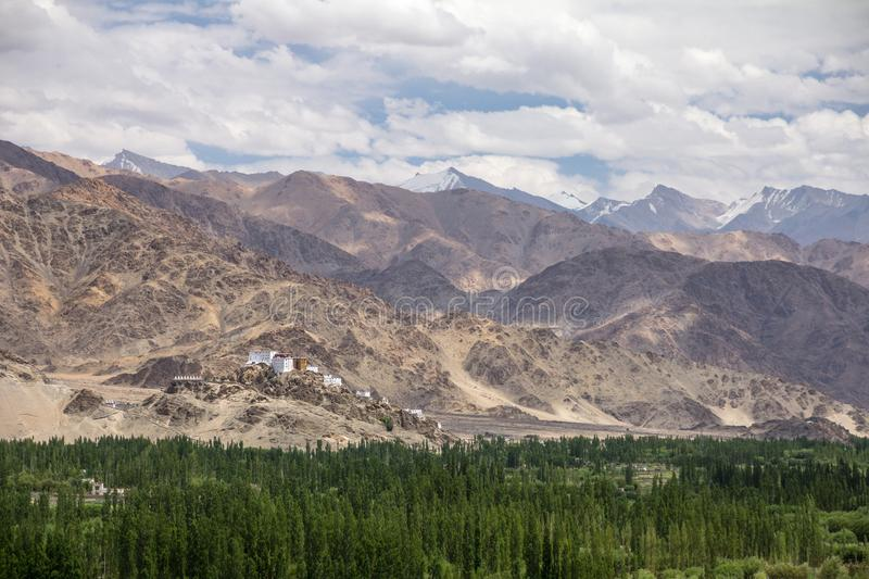 Thiksay Monastery dramatically located on a ridge, dwarfed by mo royalty free stock image