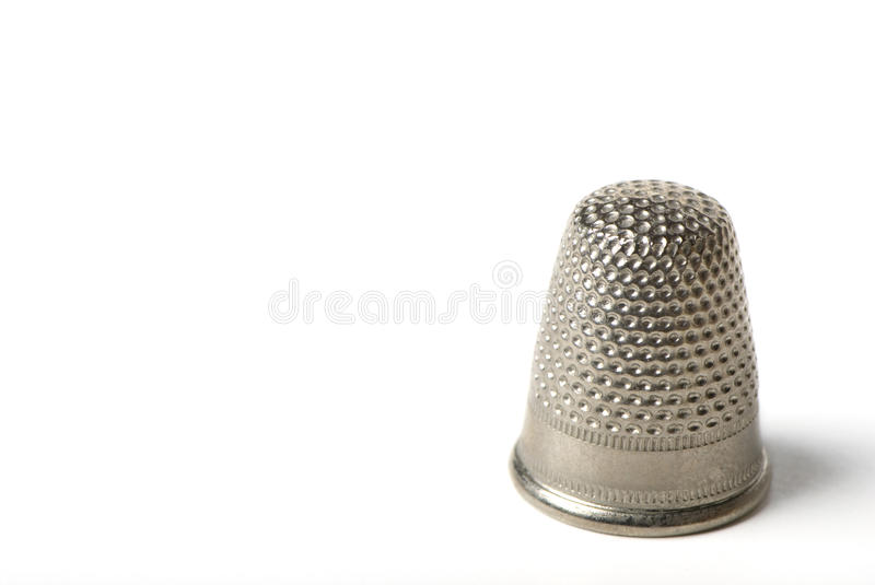Thimble. Closeup of a thimble isolated on white background royalty free stock photo