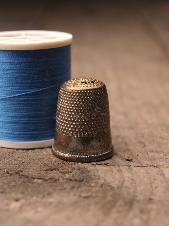 Thimble and yarn royalty free stock image