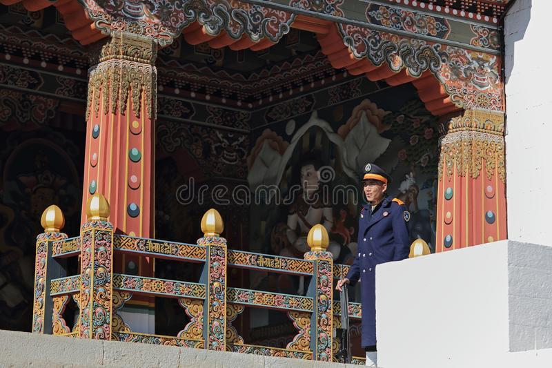 THIMPHU, BHUTAN - DEC 3, 2017: Royal honour guard on duty in front of the Tashichho Dzong. Thimphu, Bhutan. This is Buddhist Monastery and Fortress where the royalty free stock image