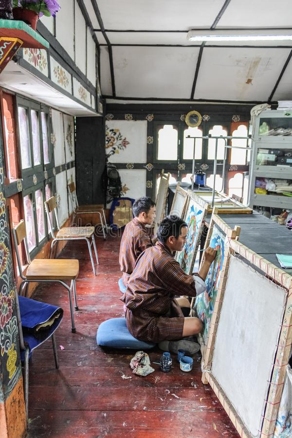 Thimphu, Bhutan - September 11, 2016: Painting students at National Institute for Zorig Chusum, Thimphu. The institute is where students learn the thirteen royalty free stock images