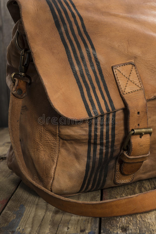 Thin Black Stripes Design on Side of Leather Satchel royalty free stock images
