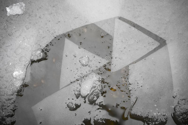 Thin Broken Ice Triangles Inside Water stock photography